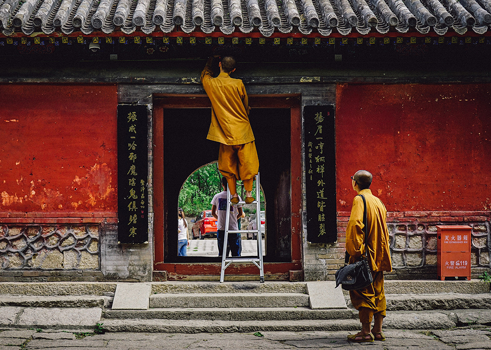 Two Buddhist monks repairing a temple